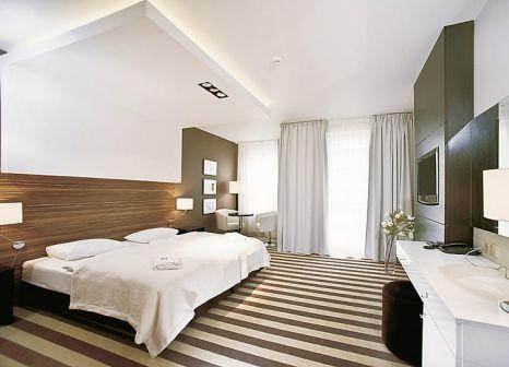 Hotelzimmer mit Mountainbike im Hotel Diva Spa