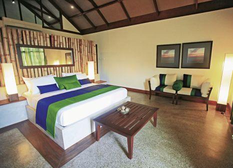 Hotelzimmer mit Mountainbike im Uga Jungle Beach