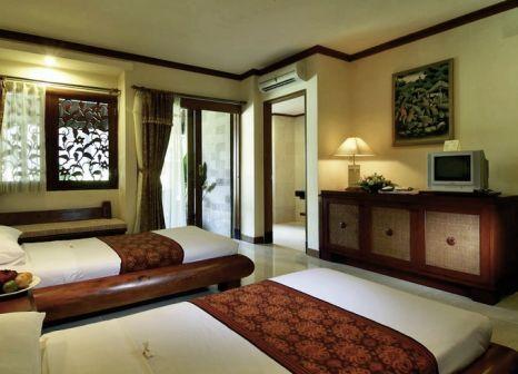 Hotelzimmer mit Mountainbike im Grand Balisani Suites