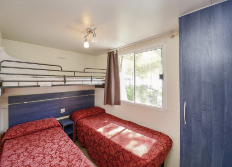 Hotelzimmer mit Mountainbike im Camping Toscolano