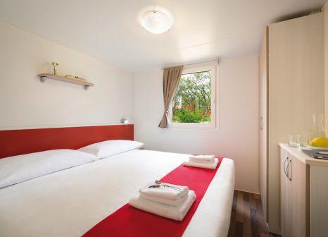 Hotelzimmer mit Mountainbike im Aminess Maravea Camping Resort