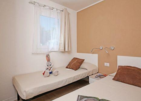 Hotelzimmer mit Mountainbike im Residence Onda Blu