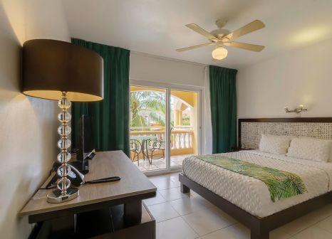 Hotelzimmer mit Mountainbike im Villa Taina