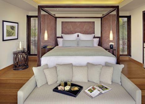 Hotelzimmer mit Mountainbike im Raffles Seychelles