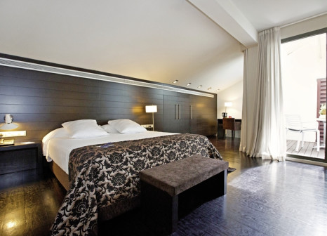 Hotelzimmer mit Mountainbike im Hospes Palau de la Mar