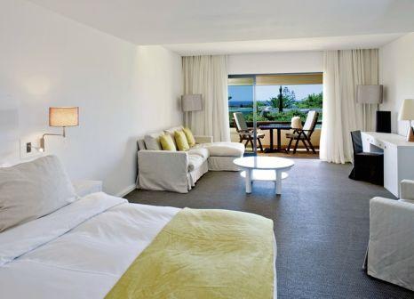 Hotelzimmer mit Mountainbike im Blue & Green Vilalara Thalassa Resort