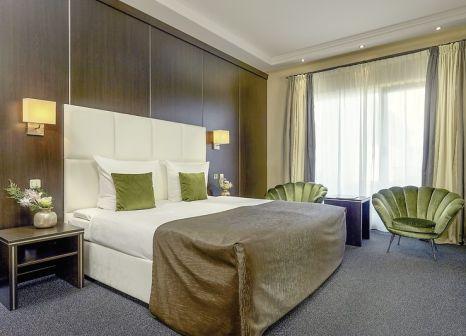 Hotelzimmer mit Mountainbike im Van der Valk Resort Linstow