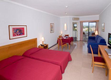Hotelzimmer mit Mountainbike im Vila Petra