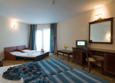 Hotelzimmer mit Mountainbike im Pelican Hotel