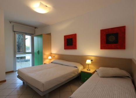 Hotelzimmer mit Mountainbike im Villaggio Planetarium Resort