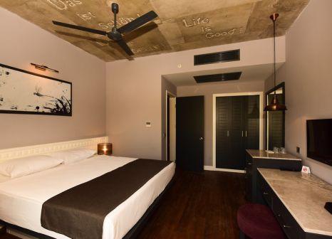 Hotelzimmer mit Mountainbike im Jiva Beach Resort