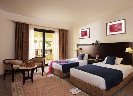 Hotelzimmer mit Mountainbike im Diamond Red Sea Resort