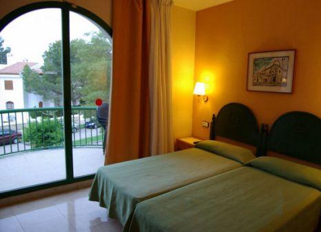 Hotelzimmer mit Mountainbike im Pino Alto