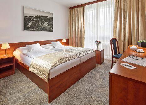 Hotelzimmer mit Mountainbike im Clarion Spindleruv Mlyn