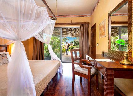 Hotelzimmer mit Mountainbike im Zanzi Resort