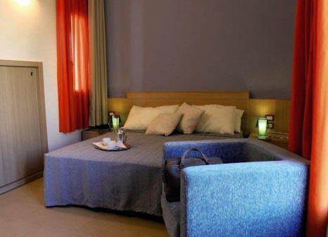 Hotelzimmer mit Mountainbike im Le Residenze Archimede