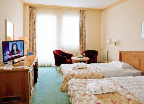 Hotelzimmer mit Mountainbike im Health Spa Resort Villa Butterfly
