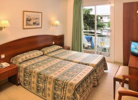 Hotelzimmer mit Mountainbike im GHT Balmes Hotel Aparthotel & SPLASH