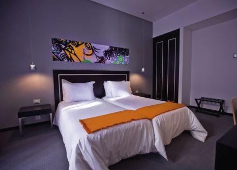 Hotelzimmer mit Mountainbike im Internacional Design Hotel