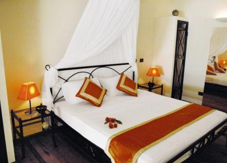 Hotelzimmer mit Tischtennis im VOI Maayafushi Resort