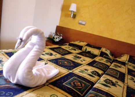 Hotelzimmer mit Mountainbike im Blue Bay