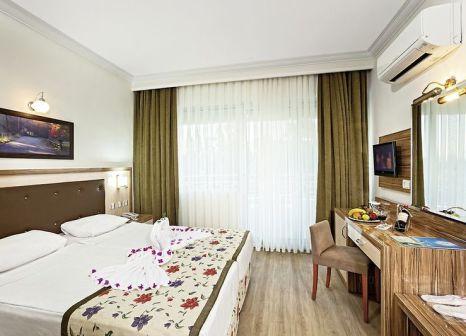Hotelzimmer mit Mountainbike im Bieno Venüs Hotel & Spa