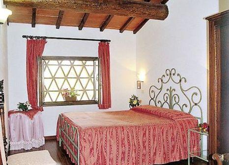 Hotelzimmer mit Golf im Il Pietreto