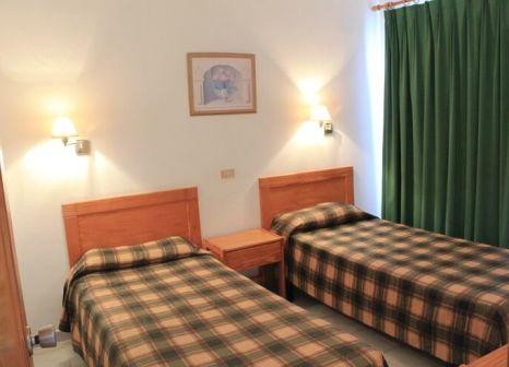Hotelzimmer mit Mountainbike im Bungalows Capri