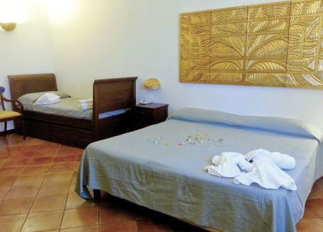 Hotelzimmer mit Paddeln im Grand Hotel La Batia