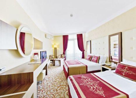 Hotelzimmer mit Mountainbike im Beach Club Doganay