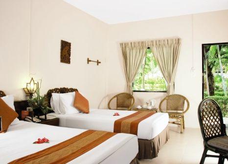 Hotelzimmer mit Mountainbike im Deevana Patong Resort & Spa