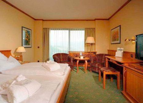 Hotelzimmer mit Mountainbike im Hotel Sonnenhof