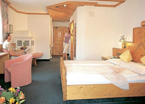 Hotelzimmer mit Mountainbike im Alpenpark Resort