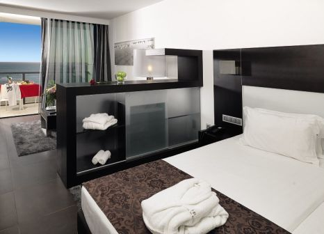 Hotelzimmer mit Mountainbike im Hotel Da Rocha