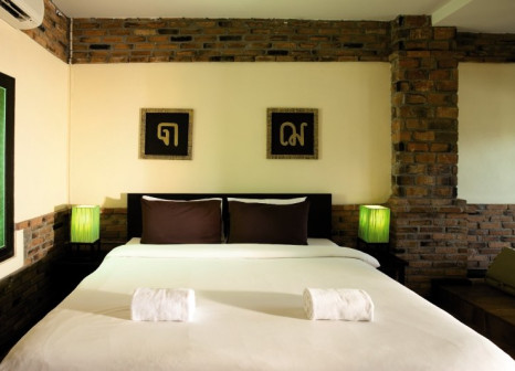 Hotelzimmer mit Paddeln im Tony Lodge & Motive Cottage Resort
