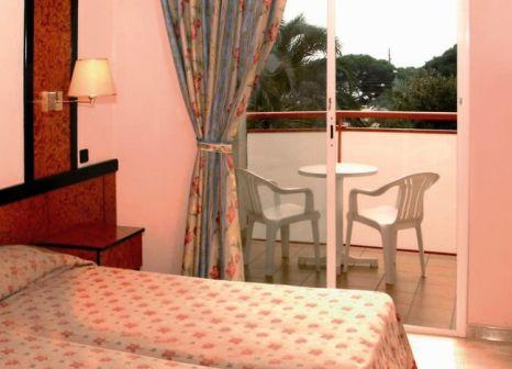 Hotelzimmer mit Mountainbike im Sumus Hotel Monteplaya