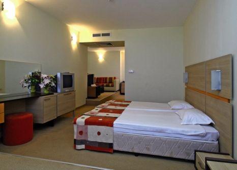 Hotelzimmer mit Mountainbike im Hotel Meridian