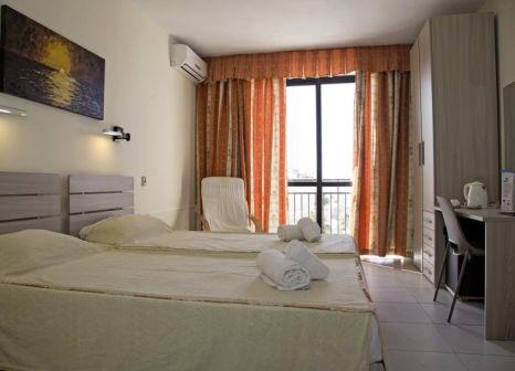 Hotelzimmer mit Hochstuhl im Relax Inn Hotel