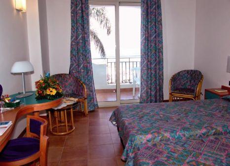 Hotelzimmer mit Mountainbike im Hotel Olimpo-Le Terrazze