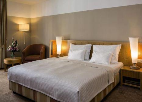 Hotelzimmer mit Mountainbike im Falkensteiner Hotel Grand MedSpa Marienbad