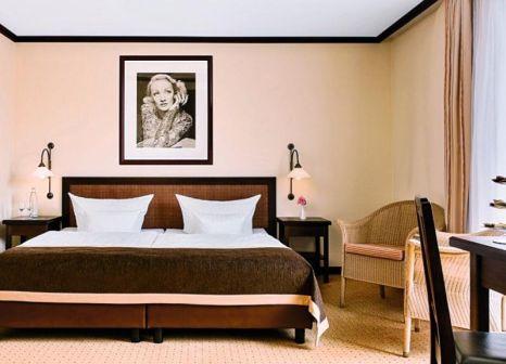 Hotelzimmer mit Hochstuhl im Steigenberger Hotel Sanssouci