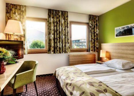 Hotelzimmer mit Mountainbike im Alphotel Innsbruck