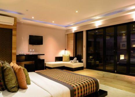 Hotelzimmer mit Tischtennis im Adaaran Prestige Vadoo