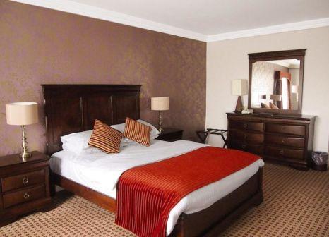 Hotelzimmer mit Hochstuhl im Cassidys Hotel