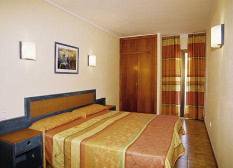 Hotelzimmer mit Mountainbike im Balansat Resort