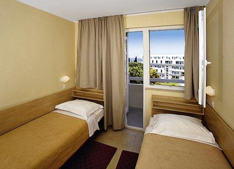 Hotelzimmer mit Mountainbike im Hotel Delfin Plava Laguna