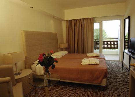 Hotelzimmer mit Mountainbike im Bomo Olympus Grand Resort