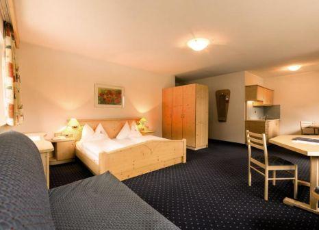 Hotelzimmer mit Mountainbike im Hotel Schneeberg Family Resort & Spa