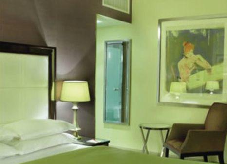 Hotelzimmer mit Hochstuhl im The Mandeville Hotel