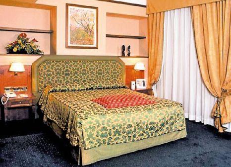 Hotelzimmer mit Hochstuhl im Cicerone Hotel